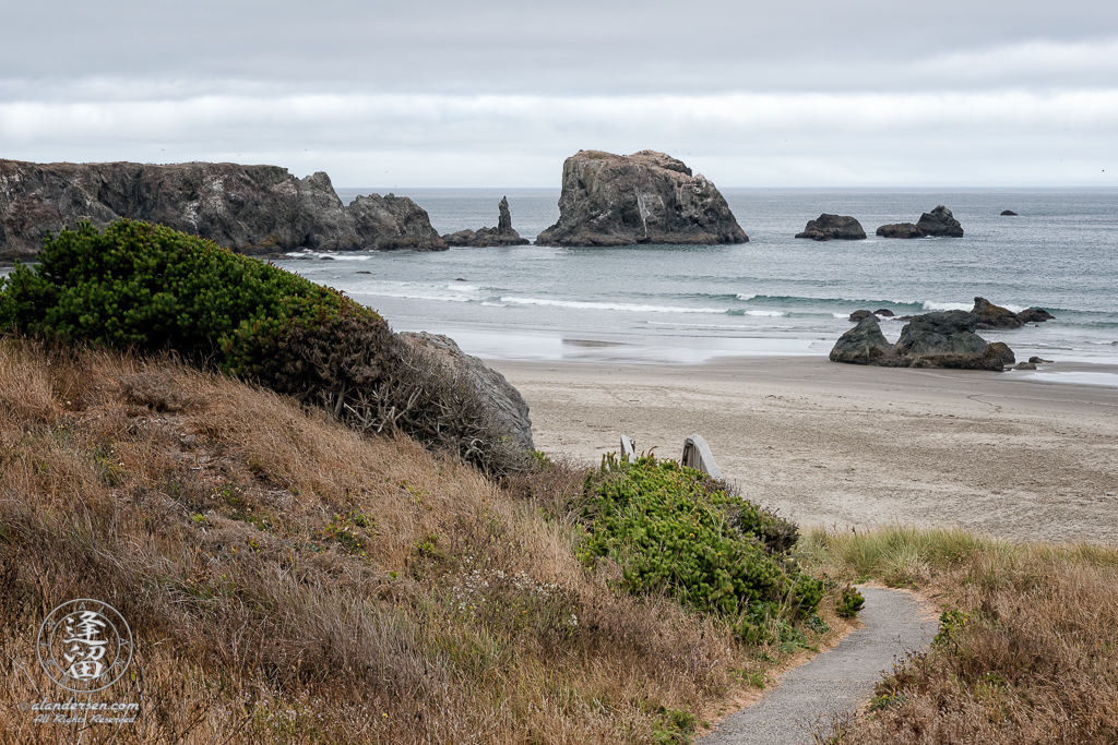 The paved path down to the beach above Coquille Point in Bandon, Oregon, looking toward Coquille Point.