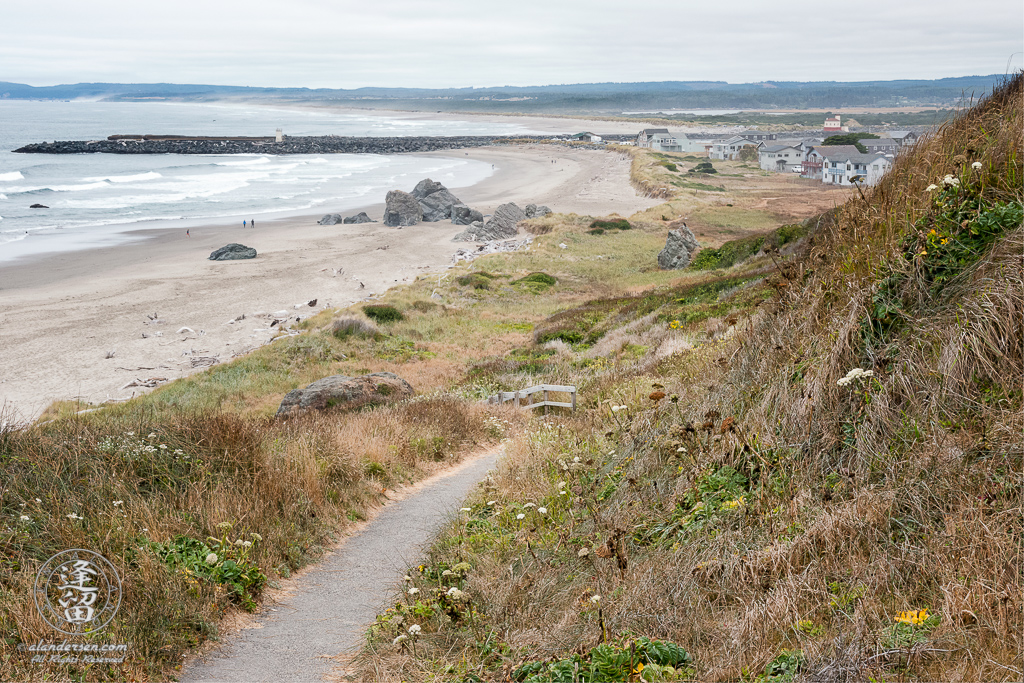 Paved path down to beach above Coquille Point in Bandon, Oregon, looking toward Bandon South Jetty Park.
