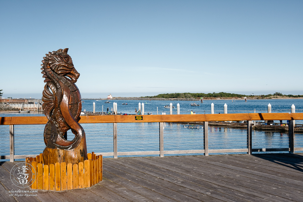 "Myrtlewood (Umbellularia californica) sculpture of a seahorse on the boardwalk at Bandon ""Old Town"" in Oregon."