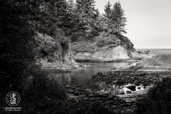 Scenic view from rock-strewn beach at Norton Gulch, which is next to Sunset Bay State Park in Oregon.
