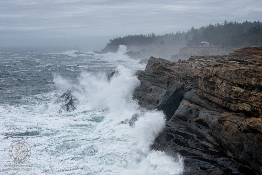 Waves pound the cliffs at Shore Acres State Park outside of Charlestony in Oregon.