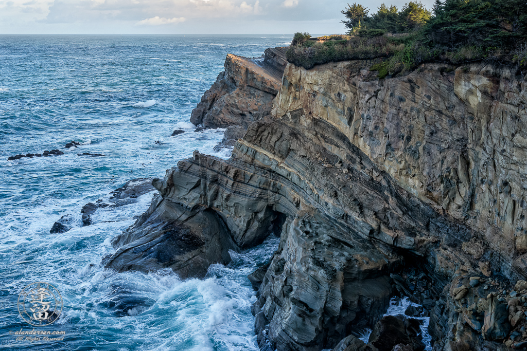Scenic view of cliffs along trail between Shore Acres State Park and SImpson Reef Overlook, outside of Charleston in Oregon.