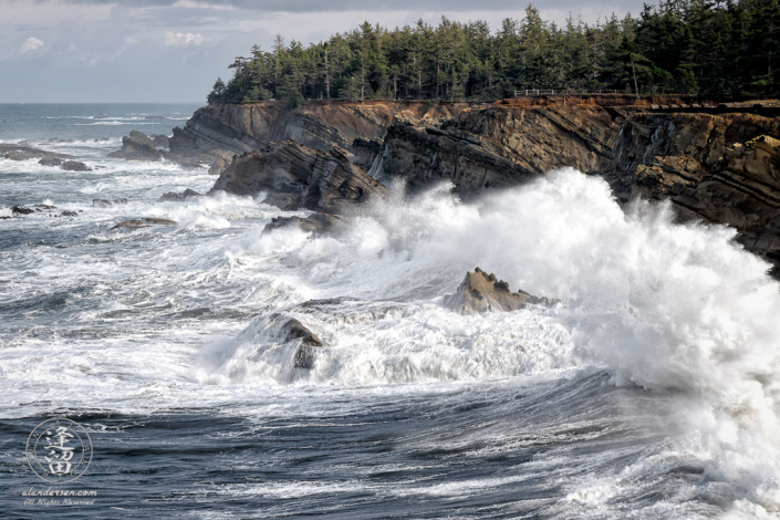 Waves pound the cliffs at Shore Acres State Park outside of Charleston in Oregon.