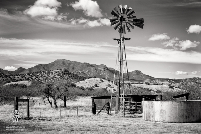 This is the windmill, water tank, and corrals at the Brown Canyon Ranch in Southeastern Arizona. Huachuca Peak (Huachuca Mountains) is in the background.